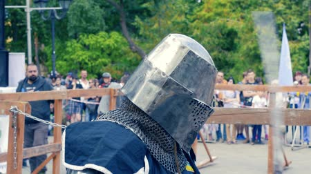 Ukraine, Kharkov August 24, 2017: Full HD Video. Knight tournament among professionals and amateurs. Preparation of the knight for battle. Heavy armor. Wideo