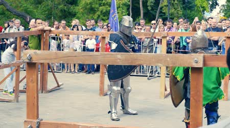 Ukraine, Kharkov August 24, 2017: Full HD Video. Knight tournament among professionals and amateurs. Combat in swords in heavy armor