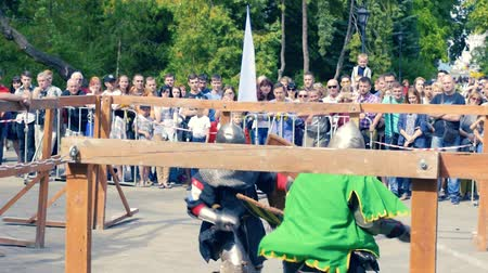 sierpien : Ukraine, Kharkov August 24, 2017: Full HD Video. Knight tournament among professionals and amateurs. Combat in swords in heavy armor