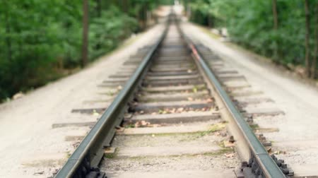 Full HD video background. Childrens railway in the citys central park. Rails, soft focus, vertical panorama.