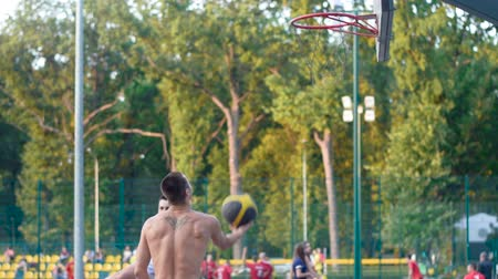 Ukraine Kharkiv Oktober 1, 2017: A player in streetball makes a slam dunk. Basketball training outdoors in the park. Healthy lifestyle. Video in full hd format