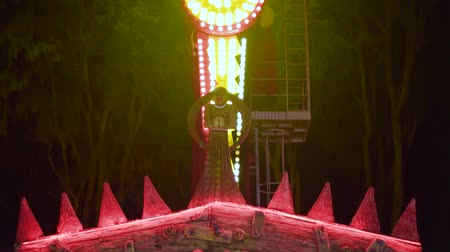 korku : Ukraine Kharkiv September 3 2017: Extreme attraction in the amusement park. Night footage, vertical panorama. Full HD video