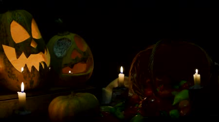 Video background for halloween. Three pumpkins with candles. Smooth horizontal slide video in full HD quality