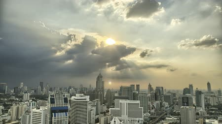 time lapse clouds : Ray of Lights through clouds over Bangkok CIty SKyline in HDR