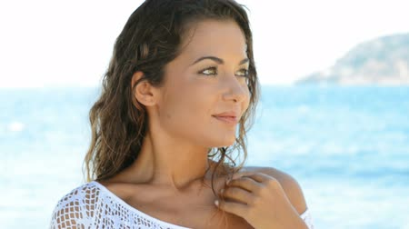 temporadas : Portrait Of Young Beautiful Woman Laughing At Summer Beach. Happy girl relaxing at the sea in a summer holiday. Stock Footage