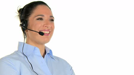 испанец : Happy  telephone operator talking with a customer and looking at camera. Young woman phone operator with headset at call center isolated on white background. Smiling girl working in a call center customer service.