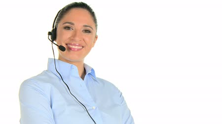 испанец : Young woman phone operator with headset at call center isolated on white background. Happy  telephone operator talking with a customer and looking at camera. Smiling girl working in a call center customer service. Стоковые видеозаписи