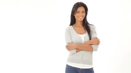 radość : Happy beautiful hispanic woman looking at camera isolated on white background. Smiling Girl with arms crossed gets her hair behind her ear. Satisfied young woman in casual walking on white background and posing with copy space.