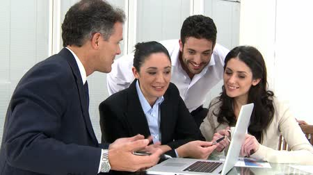 corporate : Businesspeople at working meeting with the leadership. Happy business team discussing and working together at office meeting with laptop. Stock Footage