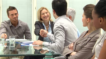hűség : Successful Business Executives Shaking Hands With Each Other.  Business people shaking hands after the meeting. Business handshake between collaborators in the modern office. Stock mozgókép