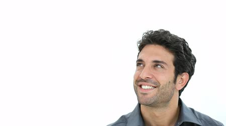 düşünürken : Happy smiling man looking up and dreaming at his future. Portrait of a guy thinking with a smile with hand on chin. Smiling young man thinking isolated on white background.