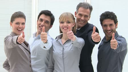 sucesso : Happy business people cheering and showing thumb up at office, Smiling business team looking at camera and showing thumb up for the success in business. Businessmen and businesswomen  showing a thumbs up.