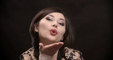 darbe : girl blows a kiss Stok Video