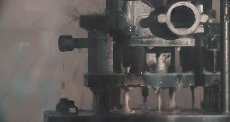 metamorphic : CNC drilling and milling in a workshop that manufactures disks and blades for cutting paper.
