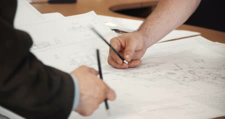 müteahhit : Design drawings and human hands drawing a project by pencil on paper Stok Video