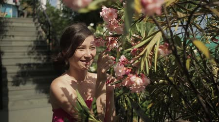smell : portrait of young lovely woman in spring flowers