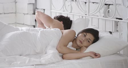 casal heterossexual : Young adult couple sleeping on the bed in bedroom Stock Footage