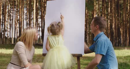 canvas : Happy family in forest walking and painting