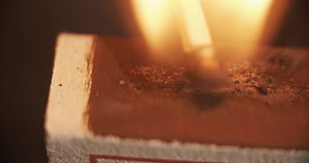 stávka : slow motion macro shot of a match igniting on fire