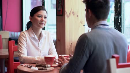 people talking : Two people in cafe laughing and talking Stock Footage
