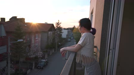 sensuous : A woman on a balcony looking at the beautiful  sunset