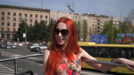 double happiness : young woman looking at the city from an open top bus Stock Footage