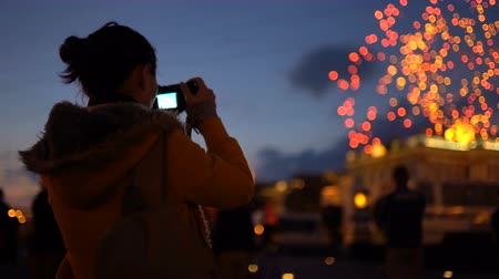pixéis : Woman taking pictures of firework Stock Footage