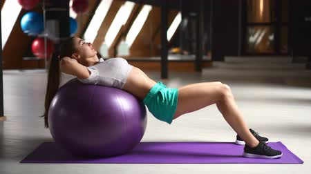 retouched : beautiful sporty sexy woman doing workout on ball