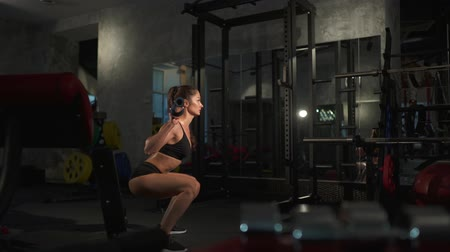 retouched : beautiful sporty sexy woman doing squat workout Stock Footage