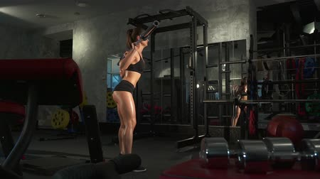 retouched : beautiful sporty sexy girl doing squat workout in gym Stock Footage