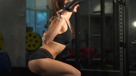 retouched : woman doing squat workout in gym Stock Footage