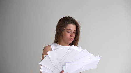 восстание : Tired businesswoman throws paper document pages Стоковые видеозаписи