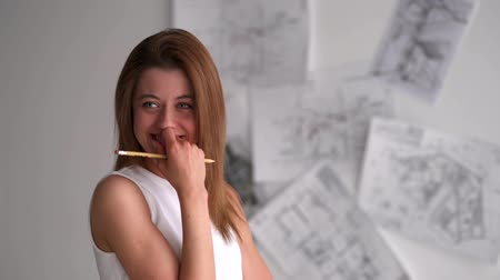 iğfal : Beautiful business woman flirting with camera with pencil Stok Video