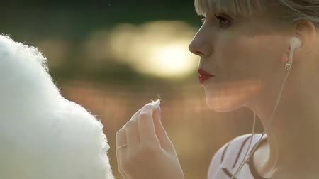 colorful candy : Young woman eating cotton candy Stock Footage