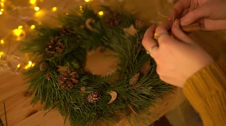 self made : Woman making xmas wreath, sticking wooden decor