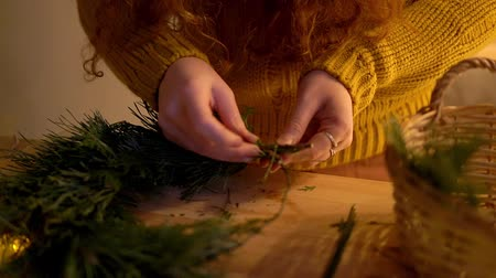 self made : Woman making christmas wreath for a holiday