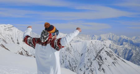 alpes : Young professional snowboarder on relax moment in french alps ski resort