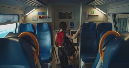 Asian girl exiting a train