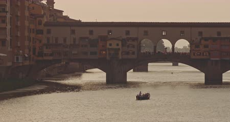 The view of Ponte Vecchio at sunset Stock mozgókép