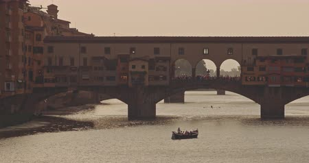 The picturesque view of Ponte Vecchio at sunset Stock mozgókép