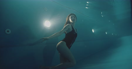 Underwater woman in swimming pool