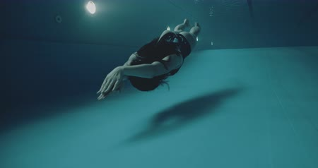 Amateur woman swimmer underwater pool