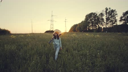 hippie : Beautiful woman playing the acoustic guitar in field