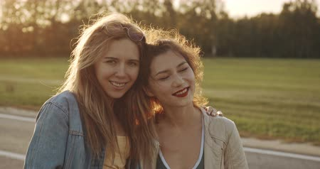 Two young smiling hipster women in summer
