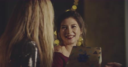 tebrik etmek : Cheerful young friends presenting gifts to a birtday girl and hugging her. Xmas, friendship, birthday, ny, lifestyle, ad, commercial concept. Close shot on 4k RED camera with 12 bit color depth.