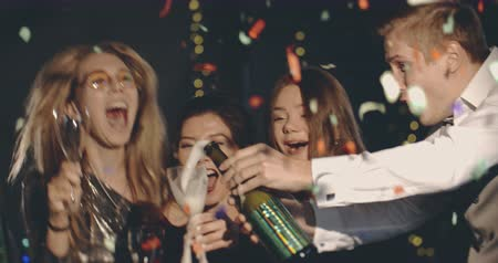 blahopřání : Festive adults celebrating xmas, slow motion of confetti and champagne exlosion. Christmas, party, vacation, lifestyle, advertising, concept. Close shot on 4k RED camera with 12 bit color depth.