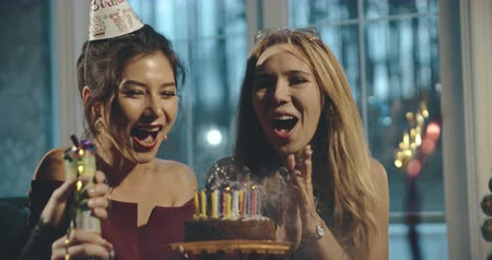 tebrik etmek : Asian birthday girl blowing candles on cake, home party. Birthday, party, family, friendship, lifestyle, advertising, commercial concept. Close shot on 4k RED camera with 12 bit color depth.
