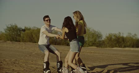 nástup do letadla : Girls helping guy to stand up on sandboard. Sport, tourism, lifestyle, commercial, advertisement concept. Shot on 4k RED camera with 12 bit color depth. Dostupné videozáznamy