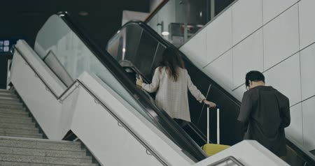 nástup do letadla : Young girl traveler walking with carrying hold suitcase in the airport. Tourist Concept. shot on camera with 12 bit color depth.