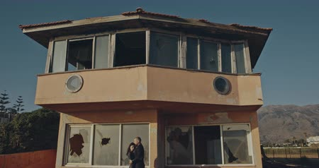 psycho : Psychodellic frame, weird couple sitting in broken home. Arthouse concept, Filmed on cinema camera, 12 bit coolor